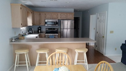 Popponesset Cape Cod vacation rental - Full kitchen with stainless appliances and breakfast bar.