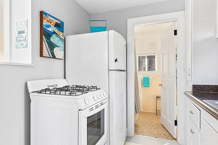 West Yarmouth Cape Cod vacation rental - Cottage kitchen and the entrance to the bathroom