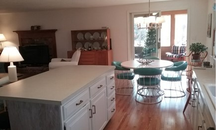 Wellfleet Cape Cod vacation rental - Dining table next to slider to screened in porch
