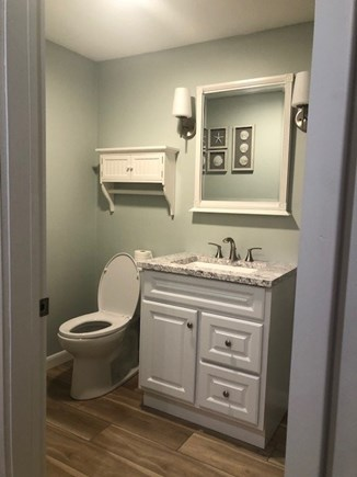 West Yarmouth Cape Cod vacation rental - New half bathroom with laundry