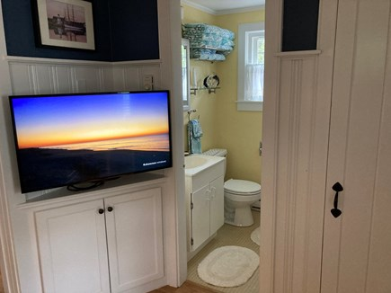Harwich Port Cape Cod vacation rental - Entertainment Nook and Bathroom