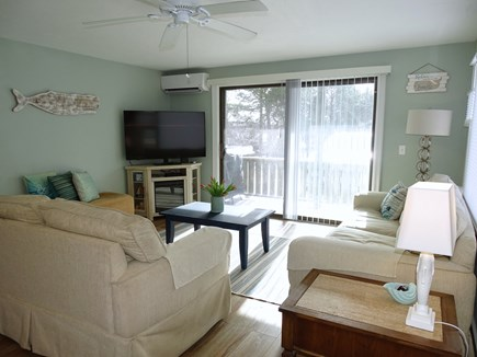 Provincetown Cape Cod vacation rental - Completely remodeled 2020 living area w/ TV, slider to deck