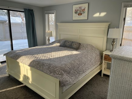 New Seabury Cape Cod vacation rental - Master Bedroom with King Bed, private Bath, and slider to pool.