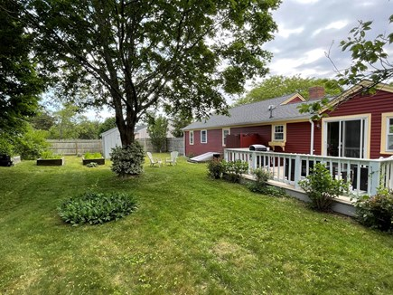 Hyannisport Cape Cod vacation rental - Fenced in backyard with spots of shade to cool down.