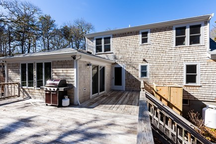 Orleans Cape Cod vacation rental - Spacious back deck with gas grill, outdoor dining setup in summer