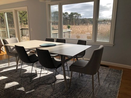 Eastham Cape Cod vacation rental - Dining area with abundant light and marsh view