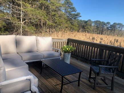 Eastham Cape Cod vacation rental - Comfortable deck with sectional, dining area and grill