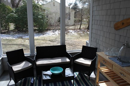South Yarmouth Cape Cod vacation rental - Screen Porch with seating and bar cart