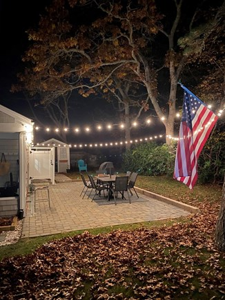 South Yarmouth Cape Cod vacation rental - Patio w/ evening lighting