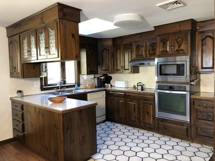 Brewster Cape Cod vacation rental - Kitchen with new electric cook top, stove and microwave.