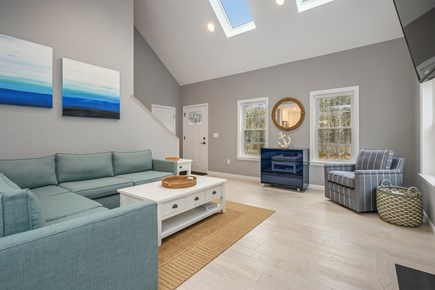 Eastham Cape Cod vacation rental - Living Room with comfortable sectional, fireplace