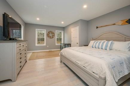 Eastham Cape Cod vacation rental - King bedroom 1 - First floor - dresser - TV - office desk -closet