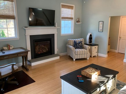 Mashpee Cape Cod vacation rental - Living Room with Desk and chair for remote work - fast wifi also