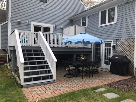 Mashpee Cape Cod vacation rental - Patio dining table for six people with BBQ grill