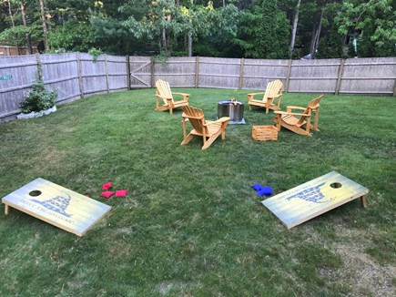 Mashpee Cape Cod vacation rental - Backyard - firepit and chairs
