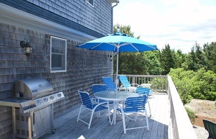 East Sandwich Cape Cod vacation rental - Side deck with gas grill and outdoor seating