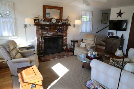 East Sandwich Cape Cod vacation rental - Fireplace in Living Room and stairway to 2nd Floor