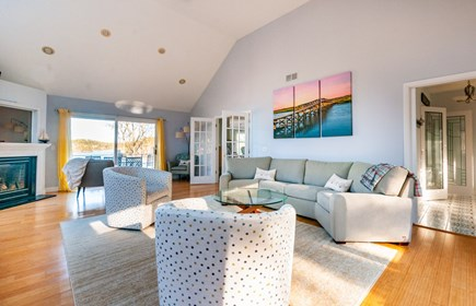 Sandwich Cape Cod vacation rental - Living Room with gas fireplace, Smart TV and sliders to deck