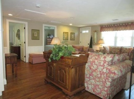 South Yarmouth Cape Cod vacation rental - Hardwood floors & ambient light throughout the open living space.