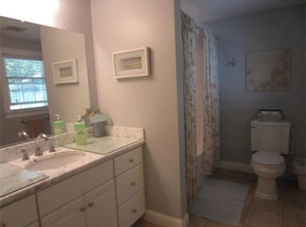 South Yarmouth Cape Cod vacation rental - Marble topped sink & tile floor compliment the tub/shower combo.