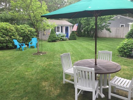 South Yarmouth Cape Cod vacation rental - Outdoor eating in spacious backyard & well-maintained landscaping