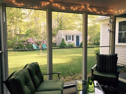 South Yarmouth Cape Cod vacation rental - Screen porch overlooking the back yard, but away from the TV.