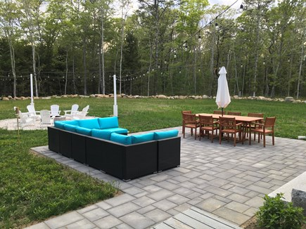 Cataumet, Scraggy Neck Cape Cod vacation rental - Back yard lounge, dining table and firepit