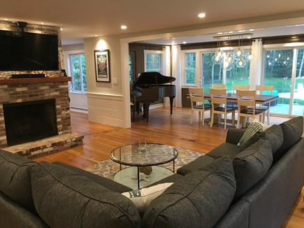 Cataumet, Scraggy Neck Cape Cod vacation rental - Living room, fireplace, dining room opening to the back yard