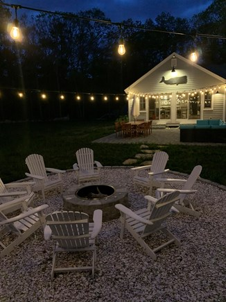 Cataumet, Scraggy Neck Cape Cod vacation rental - Firepit and outdoor lounge/dining at night