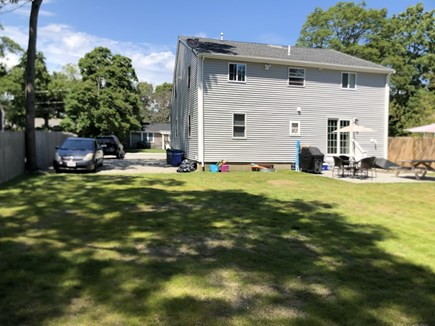 East Falmouth close to Washbur Cape Cod vacation rental - Lefr rear backyard to driveway