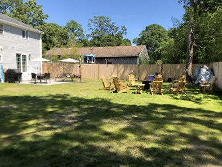 East Falmouth close to Washbur Cape Cod vacation rental - Backyard, plenty of room for children riding bikes