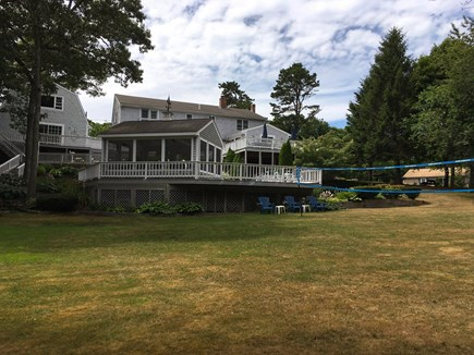 Cotuit- near Loop Beach Cape Cod vacation rental - Back Yard- flat grassy yard for games.  Camp House is on left