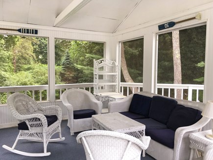 Cotuit- near Loop Beach Cape Cod vacation rental - Camp House- lower deck, screened in porch, all wicker furniture.