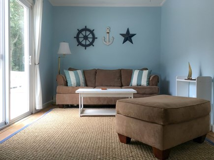 Cotuit- near Loop Beach Cape Cod vacation rental - Sun Room- sleeper sofa, slider to deck, computer and tv area