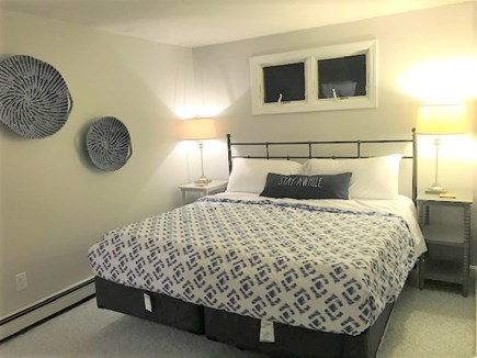 East Falmouth Cape Cod vacation rental - Master bedroom with King bed and 1/2 bath.
