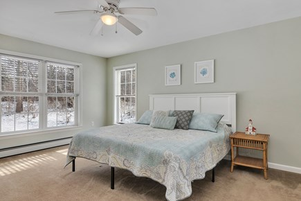 Orleans Cape Cod vacation rental - 2nd floor master suite with ceiling fan and dresser