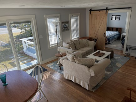 Falmouth, Maravista Cape Cod vacation rental - Open living and dining area with slider to deck.