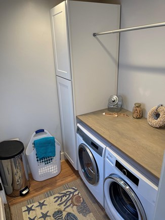 Falmouth, Maravista Cape Cod vacation rental - Laundry room with washer and dryer. Back door to large yard.