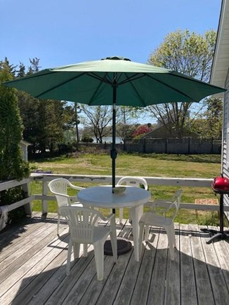 Falmouth, Maravista Cape Cod vacation rental - Private deck with views of little pond and large backyard.