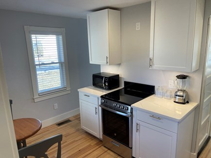Falmouth, Maravista Cape Cod vacation rental - Updated Kitchen with electric oven and microwave.