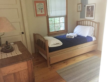 Wareham MA vacation rental - Bedroom #1 with pullout mattress under bed.