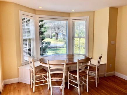 Mashpee Cape Cod vacation rental - Love me a window seat, Eat in Kitchen seats 9 around the table.