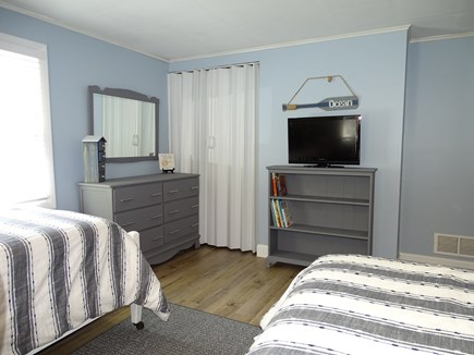 Yarmouth Cape Cod vacation rental - Twin bedroom showing bookcase and bureau