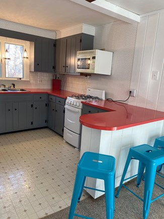 Falmouth Cape Cod vacation rental - Kitchen with full size refrigerator, microwave, and oven.