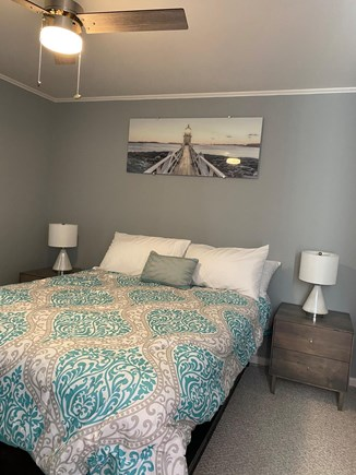 Falmouth Cape Cod vacation rental - Bedroom with queen size bed and drawers on the bottom of the bed