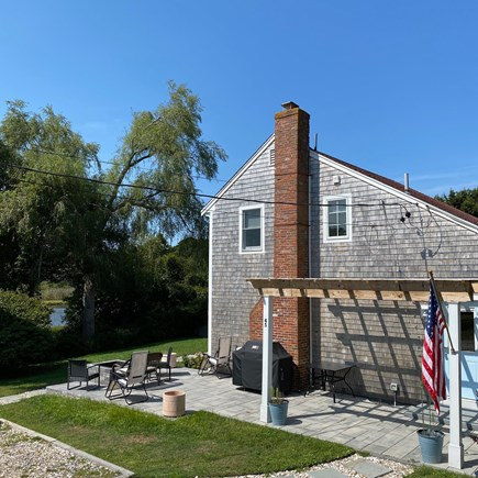Chatham Cape Cod vacation rental - Oversized patio with fire pit and water views