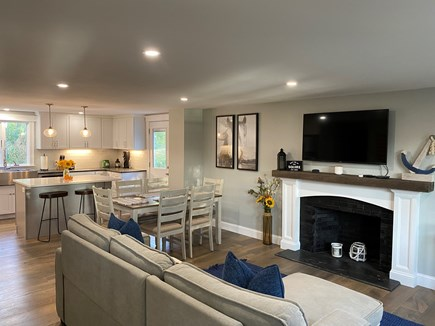 Chatham Cape Cod vacation rental - Living area with flat screen TV, fireplace, dining or work space