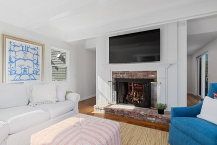 Chatham Cape Cod vacation rental - 65 inch smart TV with cable and fireplace for cozy movie nights