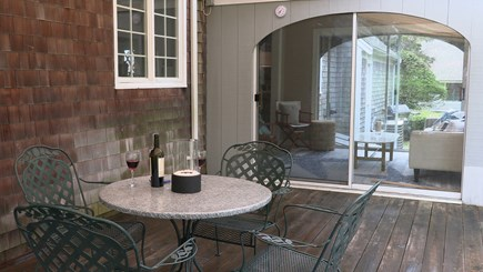 Cotuit Cape Cod vacation rental - Sun-filled deck with tables, chairs and retractable awning