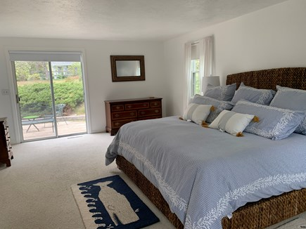 Cotuit Cape Cod vacation rental - Master bedroom w/ensuite bath and slider to deck (1st fl): King